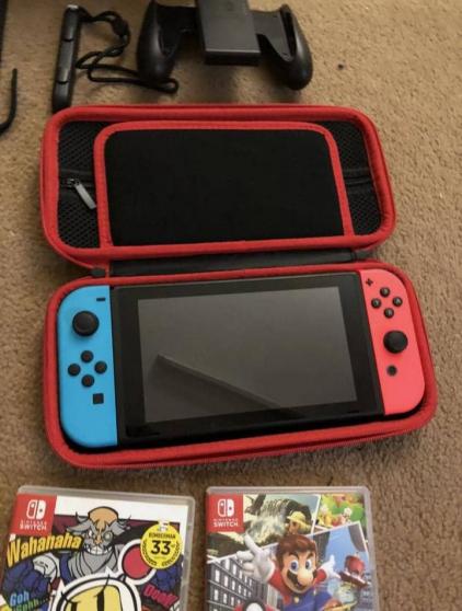 Nintendo Switch en bon état - Photo 2