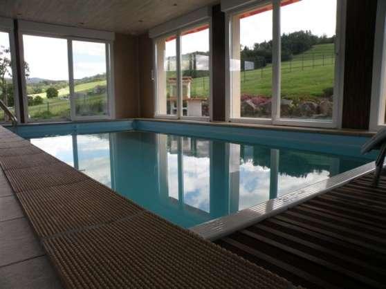 location chalet avec piscine intérieure