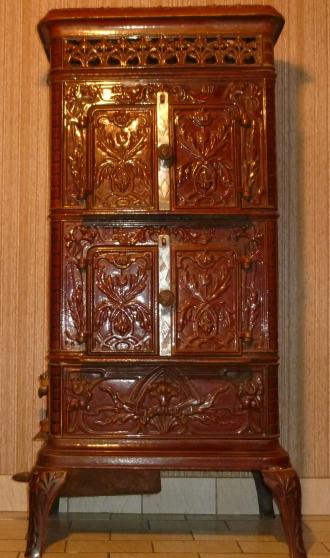 fourneau ancien en fonte maill e antiquit art brocantes meubles anciens seichamps. Black Bedroom Furniture Sets. Home Design Ideas