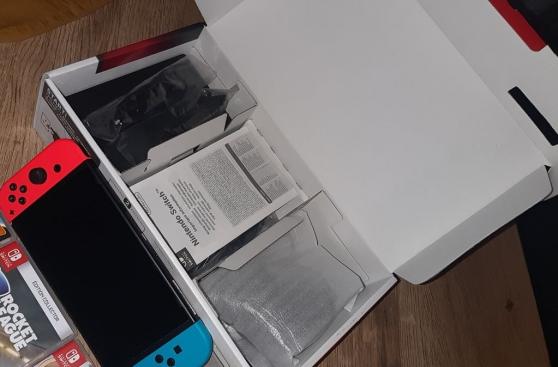 Nintendo Switch + 4 jeux