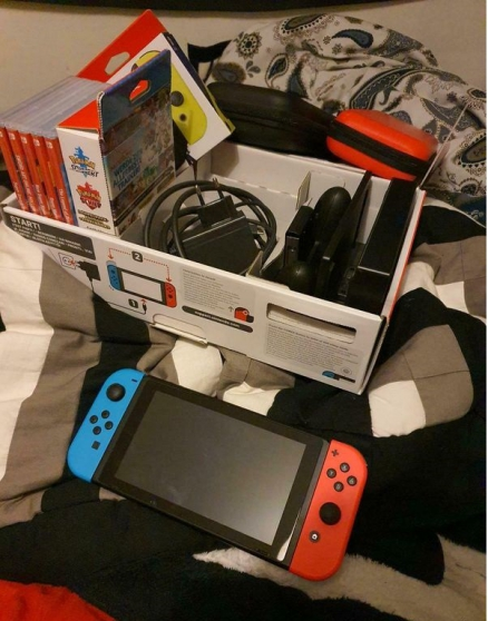 Nintendo Switch + 10 Jeux + Sac + 128Gb