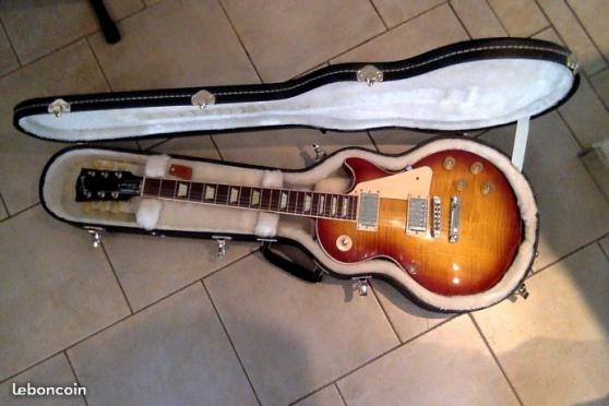 """Petite Annonce : Gibson les paul \""""traditional \"""" - Bonjour Je vends une Gibson de 2012 avec son flying case. envoi"""
