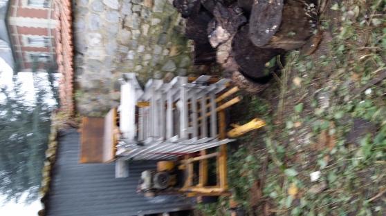 Loue monte lève matériaux meuble tuile