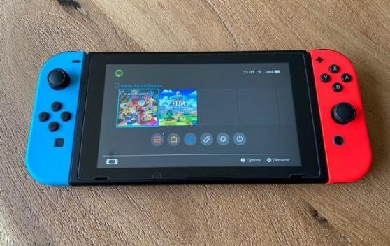 Nintendo Switch V2 avec jeux et accessoi - Photo 2