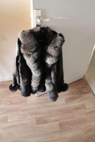 Manteau cuir et fourrure femme