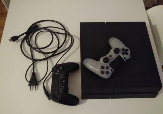 PS4 d'1 To avec 2 manettes et 38 jeux