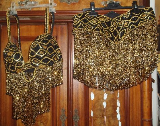 Costume professionnel noir-or de danse o