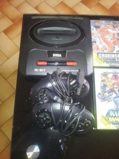 séga méga drive+2 manettes+jeux