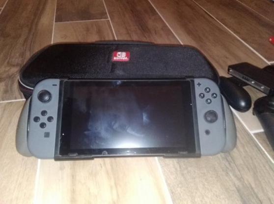 Nintendo Switch en très bon état + 6 jeu - Photo 2