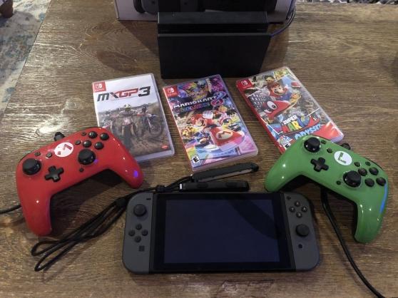 Nintendo swicth avec 3 jeux envoie