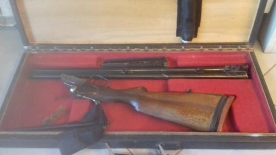 Fusil calibre 12 juxtaposé dans malette.