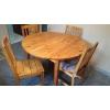 Table ronde à rallonges et chaises